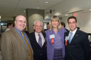 Four School of Public Affairs alumni pose for a photo at the 75th Anniversary.